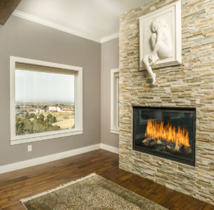floor to ceiling stone fireplace built by DM Builders, Idaho home construction