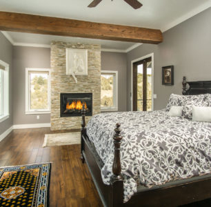 master bedroom with fireplace built by DM Builders, Idaho home construction