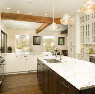 custom kitchen with white tile and cabinets, exposed wood beams in ceiling, DM Builders