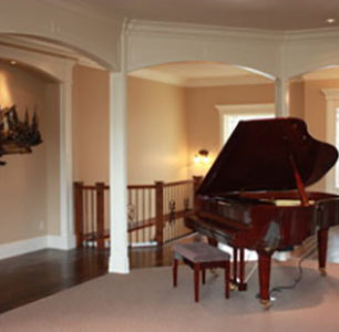entry way with columns and baby grand piano built by DM Builders, Idaho home construction