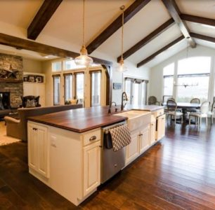 Beautiful custom white kitchen with natural wood accents and beams. Idaho Falls Home Builders