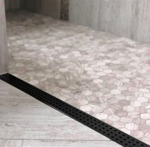 Natural grey tile, Floor Level Linear Drain for Full ADA compliant access to shower