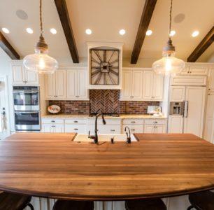 Wood island in custom kitchen by Idaho home builders, DM BUILDERS